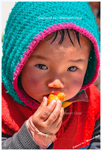 Kid Enjoying a Snack | Kungri Monastery (Pin Valley) Festival