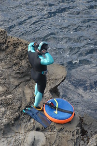 © Joseph Dougherty. All rights reserved.  Suiting up to go abalone diving.