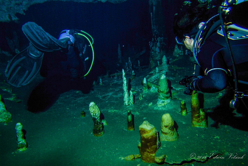 Raul (left) and Chérie diving over stalacmites grown on the cave's floor