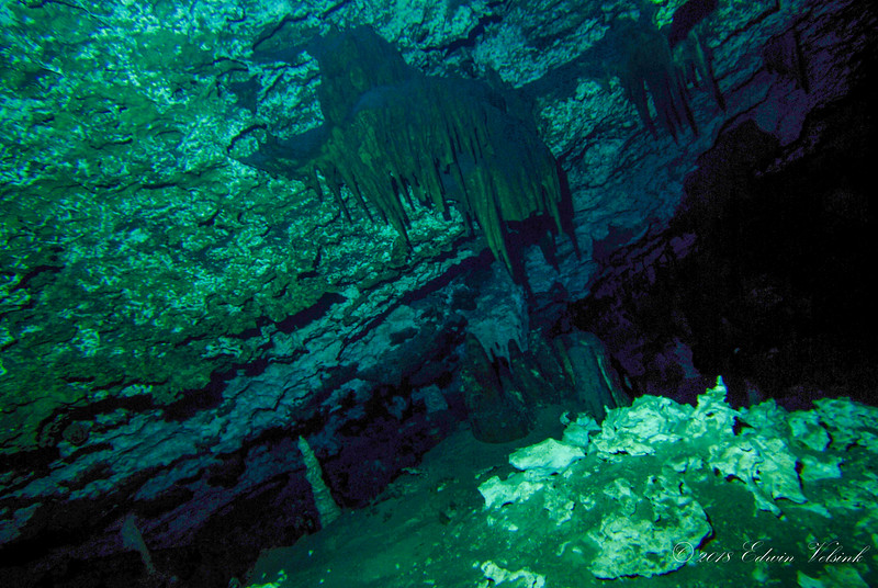 The walls of the subterranean river are covered with fabulous dripstone formations