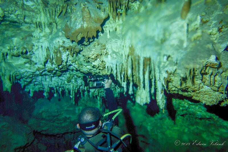 Raul and his GoPro in awe for a beautiful wall of stalagtites
