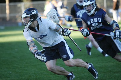 players from NDNU division 2 Lacrosse team practice on Koret Field on campus in Belmont.