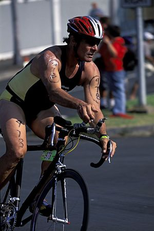 The second phase of the Kona Ironman Triathlon is the bike, 2003, this is Kona local Carl Ko'omoa riding his one-of-a-kind bamboo bicycle. The Big Island, Hawaii ( Central Pacific Ocean )<br /> 2