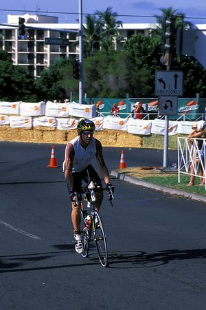 "The second phase of the Kona Ironman Triathlon is the bike, 2004, This is Kona local Tim Taylor as he passes ""Hot Corner"" The Big Island, <br /> Hawaii ( Central Pacific Ocean )<br /> 1"