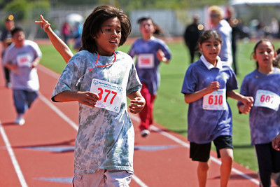 Christian Cruz 11, wins the 1 mile run competition during the Super Sports Day, a track  and field meet for students in San Mateo County Special Education programs at Burlingame High School.
