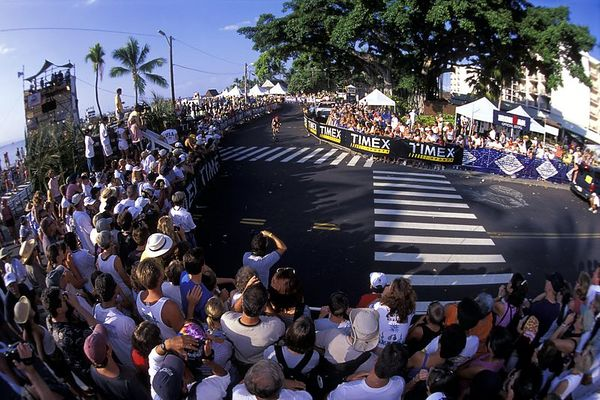 The second phase of the Kona Ironman Triathlon is the bike, 2003, this is how it looks as they exit the water from the swim and rocket off of the Kailua pier for the beginning of the bike race, The Big Island, <br /> Hawaii ( Central Pacific Ocean )<br /> 1