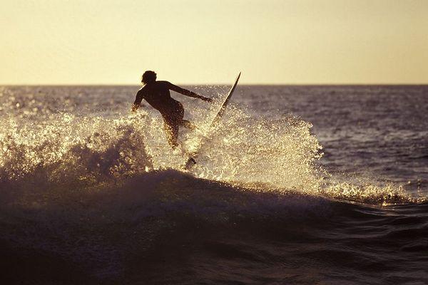 surfer at Magic Sands or La'aloa Beach Park, <br /> Big Island of Hawaii <br /> ( Central Pacific Ocean )<br /> 1