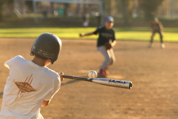 Kids ages 11 and 12 of Bay West, a part of Burlingame Baseball Association, practice at Bayside Park in Burlingame.