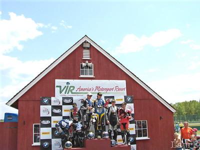 the winning teams on the podium