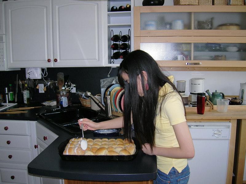 Ji Yoon putting crosses on hot cross buns -