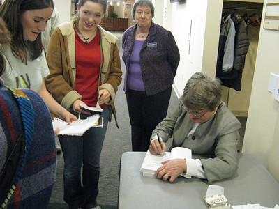 Signing her books.