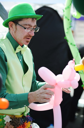 Globe/T. Rob Brown<br /> Dexter Miller, of Saginaw, owner of Balloon GuyZ, makes animal balloons for children Saturday morning, March 16, 2013, during St. Patty's Fest on Joplin Street in downtown Joplin.