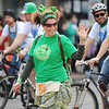 Globe/T. Rob Brown<br /> Rebuild Joplin members wave to the crowd during the St. Patrick's Day Parade on Main Street Saturday morning, March 16, 2013, in downtown Joplin.