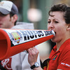 Globe/T. Rob Brown<br /> Ruth Sawkins, of Joplin, race director of the St. Patty's Revenge 5K, encourages runners with a megaphone as they near the finish Saturday morning, March 16, 2013, on Main Street in downtown Joplin.