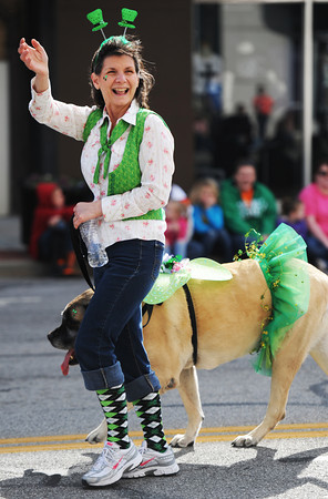 Globe/T. Rob Brown<br /> A participant in the St. Patrick's Day Parade waves to the crowd on Main Street Saturday morning, March 16, 2013, in downtown Joplin.