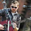 Globe/T. Rob Brown<br /> Folk rock singer Gino Gebelin, of Pittsburg, Kan., performs Saturday morning, March 16, 2013, during St. Patty's Fest on Joplin Street in downtown Joplin.