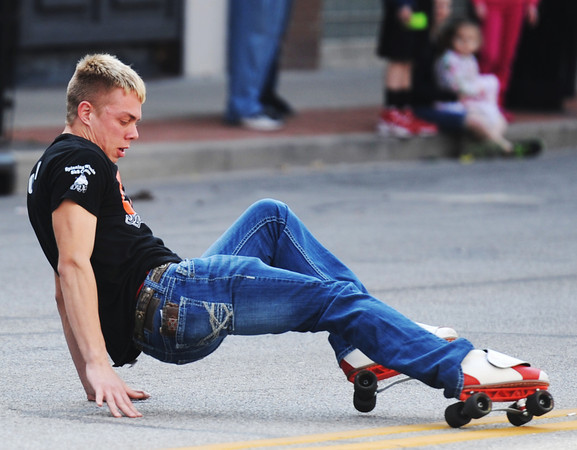 Globe/T. Rob Brown<br /> Marcus Donham, of Carl Junction, a rollerskating enthusiast, demonstrates his skills during the St. Patrick's Day Parade on Main Street Saturday morning, March 16, 2013, in downtown Joplin.