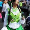 Globe/T. Rob Brown<br /> Amanda Almich, of Granby, gets into Irish character as she talks to people Saturday morning, March 16, 2013, during St. Patty's Fest on Joplin Street in downtown Joplin.