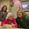 Marjorie Steele, an almost-lifelong resident of Arlington, now of Tewksbury, poses for a photo with nieces Juanita Jaillet of Londonderry, N.H., left, and Lolita Lopez of Townsend (sisters), as she celebrates her 100th birthday today at Blaire House in Tewksbury. (SUN/Julia Malakie)