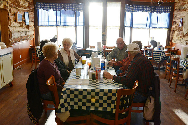 Globe/Roger Nomer<br /> In early morning sun, customers gather for breakfast at the Lentz-Carter Cafe on Friday morning. The breakfast is a weekly ritual at the cafe, which is a central meeting spot in Stella.