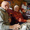 Globe/Roger Nomer<br /> Chuck Dalbom, left, talks with Don Hounschell and Herb Frencken over breakfast at the Lentz-Carter Cafe on Friday morning.