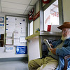 Globe/Roger Nomer<br /> Jack Link does a puzzle as he waits for the mail to arrive at the Stella Post Office.