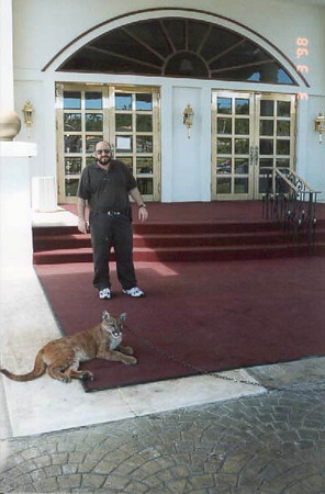 A mountain lion I call him Buddy and me in front of the Sandcastle in Guam