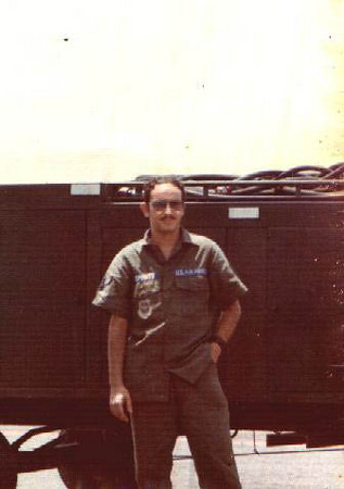 Standing in front of equipment at Clark air base in the Philippines