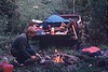 Breakfast On The Line<br /> <br /> What memories this brings back, as I shot this photo in 1971 while working on a Seismic Crew. <br /> <br /> That is our survey hack, and we were camped out in the back-country on the Morley First Nations reserve west of Calgary, where we were doing oil exploration for Mobile Oil.<br /> <br /> I must have been tougher in those days, as you can see that we were sleeping on the ground, without a tent.<br /> <br /> That is my friend Clair cooking up hot dogs for breakfast.<br /> <br />  Clair, I bet your fussier than that today!