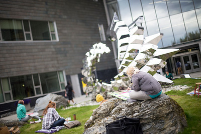 Students drawing the sculpture outside of the ConocoPhillips Integrated Science Building on the campus of the University of Alaska Anchorage.  20170912-sculpture-drawing-TEK-002.JPG
