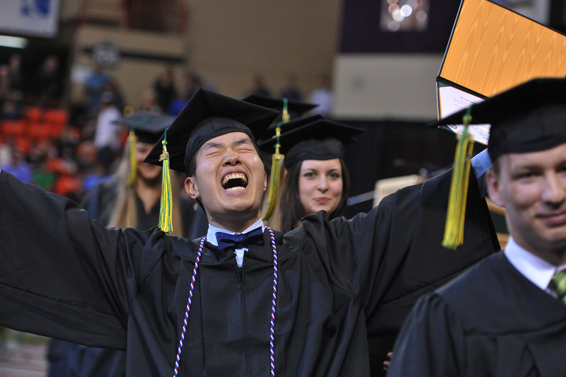 """Samuel Oh expresses his delight at his success at the UAA commencement ceremony Sunday, May 6, 2012.  Photo courtesy UAA/Michael Dinneen  <div class=""""ss-paypal-button"""">120505 Commencement-2-3.jpg</div><div class=""""ss-paypal-button-end""""></div>"""