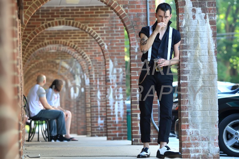 Joey Napolizzi is wearing a white Dickey suspenders; black cotton Levis; black cotton shirt; black and white Bolano wingtups; brass metal wallet chain at Trolly Square in Wilmington. Sepecial to the News Journal/Don Blake
