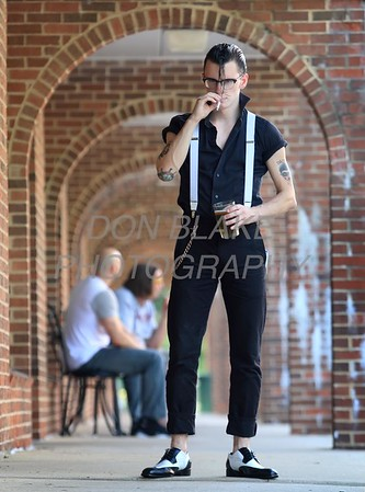 Joey Napolizzi is wearing a white Dickey suspenders; black cotton Levis; black cotton shirt; black and white Bolano wingtups; brass metal wallet chain; RayBans eyeglasses at Trolly Square in Wilmington. Sepecial to the News Journal/Don Blake