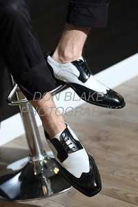 Joey Napolizzi is wearing a black and white Bolano wingtups; black cotton Levis at Trolly Grooming Lounge in Wilmington. Sepecial to the News Journal/Don Blake