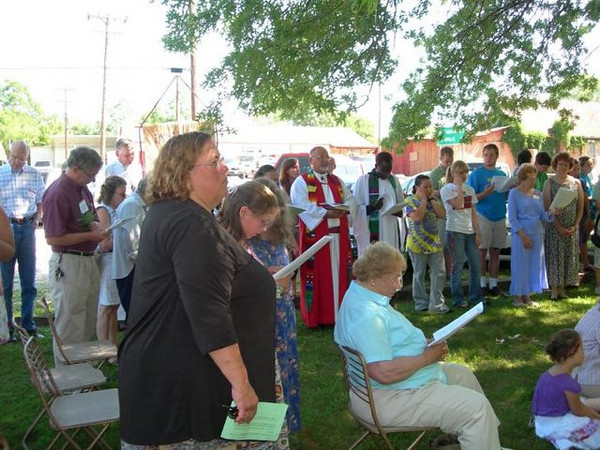 After worship on June 28, we gathered outside to open the earth for our addition.