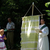 Abigail with Tim Fleck, in his first visit as a Deacon, holding the Unfinished Kingdom banner