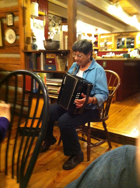 Phyllis the accordion player at a choir party