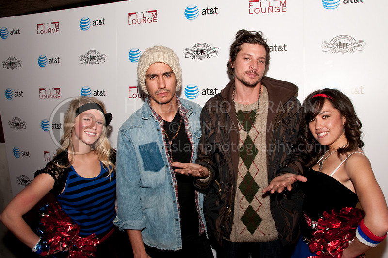PARK CITY, UT - JANUARY 24: Actor John Davila (L) and Simon Rex (R) pose with unidentified women for the 'HIGH school' premiere party at The Film Lounge on January 24, 2010 in Park City, Utah.