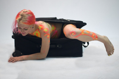 Suzi West modeling in a suitcase.  Photography by John Shippee Photography, hair, makeup, and modeling by Suzi West.