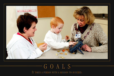 Our therapists help in many areas including feeding and communication as shown in this picture.