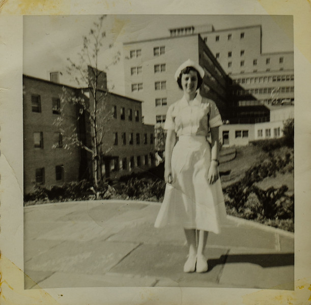 May 1959 On the patio behind our residence. That's the hospital in the background. Ellie