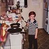 Remington Jarvie flipping the pancakes Christmas morning
