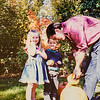 They are so excited. Jay's cutting the top off. What a sweet dad. Micheala, Remington, Jay Jarvie 1994