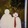 Oct. 31, 1994 Ready to go trick or treating (in the rain of course). Have you ever seen such cute ghosts? Micheala and Remington