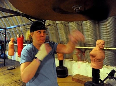 Tawnia Wormell, 42, uses the speed bag during a workout at Front Range Boxing Academy in Boulder. Cliff Grassmick / November 12, 2009