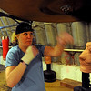 Tawnia Wormell, 42, uses the speed bag during a workout at Front Range Boxing Academy in Boulder.<br /> Cliff Grassmick / November 12, 2009