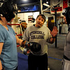 Trainer Dave Gaudette, center, has some advice for Chris Johnson, right, as Tawnia Wormell looks on at Front Range Boxing Academy.<br /> Cliff Grassmick / November 12, 2009