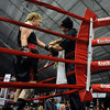 Dave Gaudette works on the final details of Tawnia Wormell's gloves before her first professional bout.<br /> Cliff Grassmick / November 12, 2009