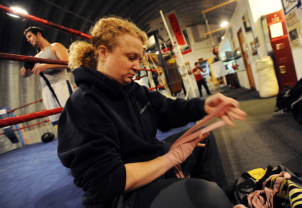 Tawnia Wormell wraps up to workout at Front Range Boxing Academy in Boulder.<br /> Cliff Grassmick / November 12, 2009