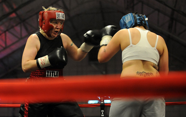 Tawnia Wormell, left,  throws a punch at Rachel Griego in her first professional fight.<br /> Cliff Grassmick / November 12, 2009